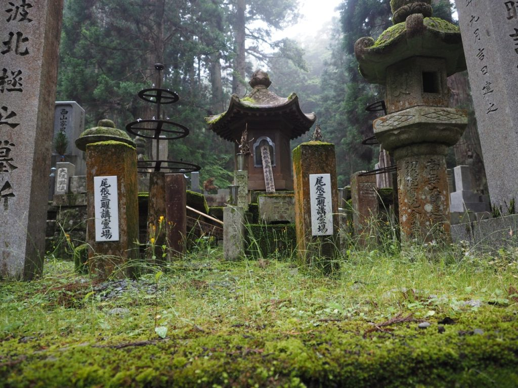 Gravestones are covered in moss in Okunoin Cemetery – Japan's largest cemetery – at Mount Koya. The cemetery is set high amongst 600-year-old cedar trees, where mountain fog creates a mysterious atmosphere. Image: Alison Binney