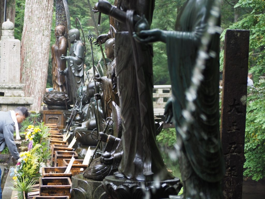 It is etiquette to 'purify' yourself before entering a Japanese temple. Water ladles are used to wash your hands and rinse out your mouth. You can also pour water over the statues to purify yourself. Image: Alison Binney