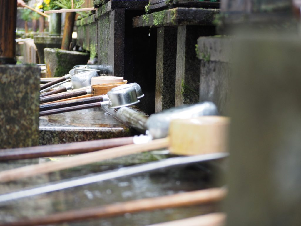 It is etiquette to 'purify' yourself before entering a Japanese temple. These ladles are used by worshipers and visitors alike to wash their hands and rinse out their mouths. Image: Alison Binney
