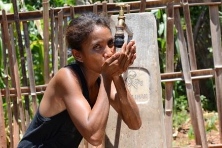 Carmelita da Cruz, a resident in the Lullibaba village of Liquiça in Timor-Leste, no longer needs to walk 2 hours every day to fetch water for her home. Image credit: Alison Binney